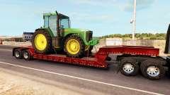 Низкорамный трал с грузом трактора John Deere